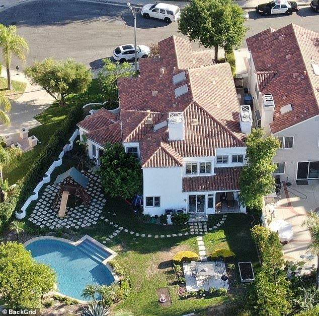 A neighbor exclusively told DailyMail.com they heard the residents of the Presley's $1.8 million property (pictured) partying at 1am, before a woman was heard screaming loudly, 'don't do it', at 3.30am - although the neighbor didn't hear a gunshot