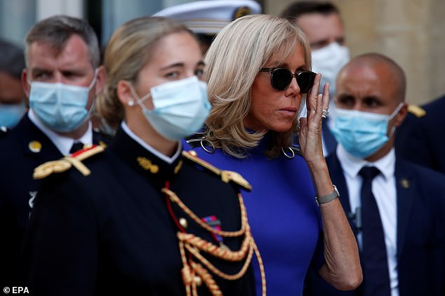 Brigitte was not wearing a mask, but sunglasses. She listened to Macron thank the French military forces for their efforts in the fight against the coronavirus pandemic