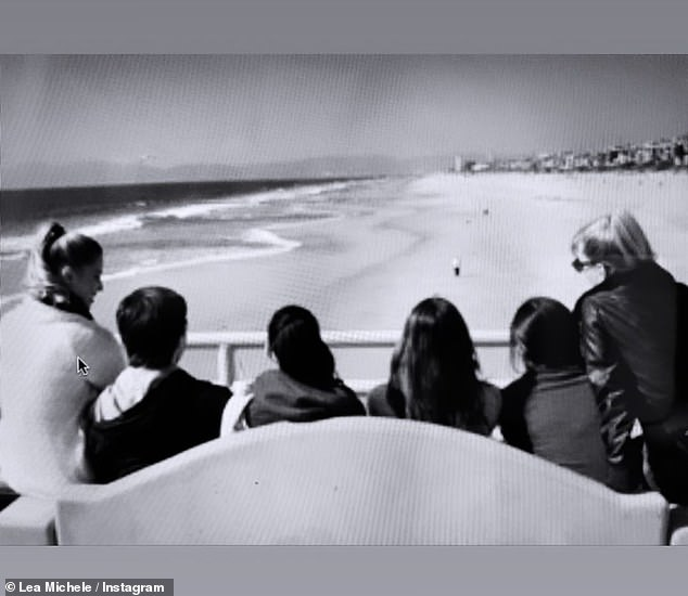 Memories: A third photo showed Lea with Naya and other Glee stars on a bench overlooking the beach