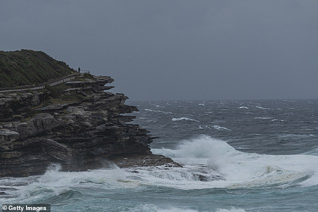 Heavy surf is pictured at Mackenzies Bay. The rough conditions were expected to cause damage and coastal erosion in parts of NSW from Tuesday afternoon