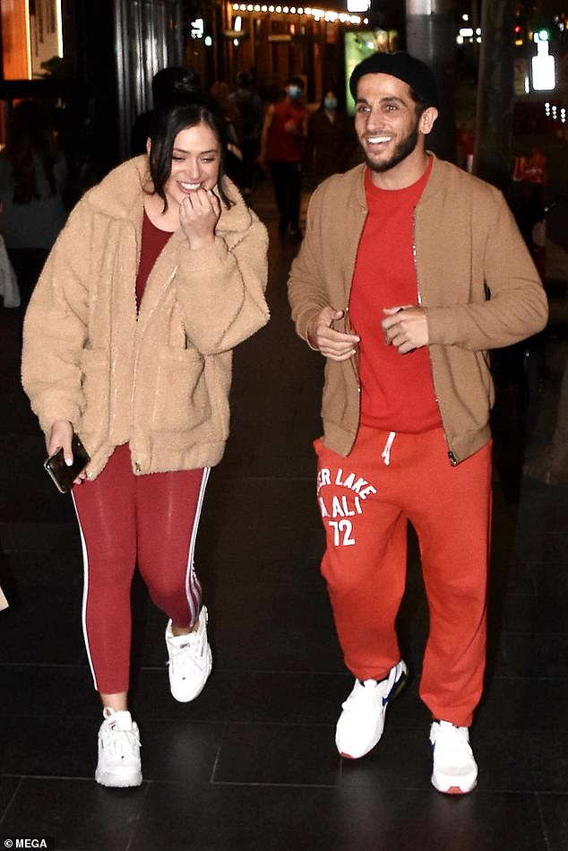 Perfect match: Firass and his companion were dressed in similar ensembles, with both opting for red, white and camel-coloured outfits