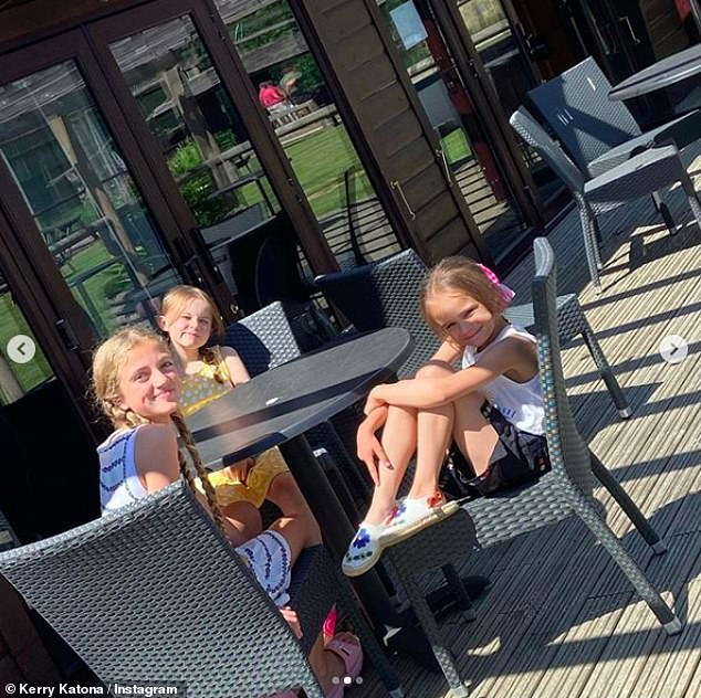 Loving: The group was joined by Katie Price's daughter Princess, 13, (left) as Harvey remains in intensive care