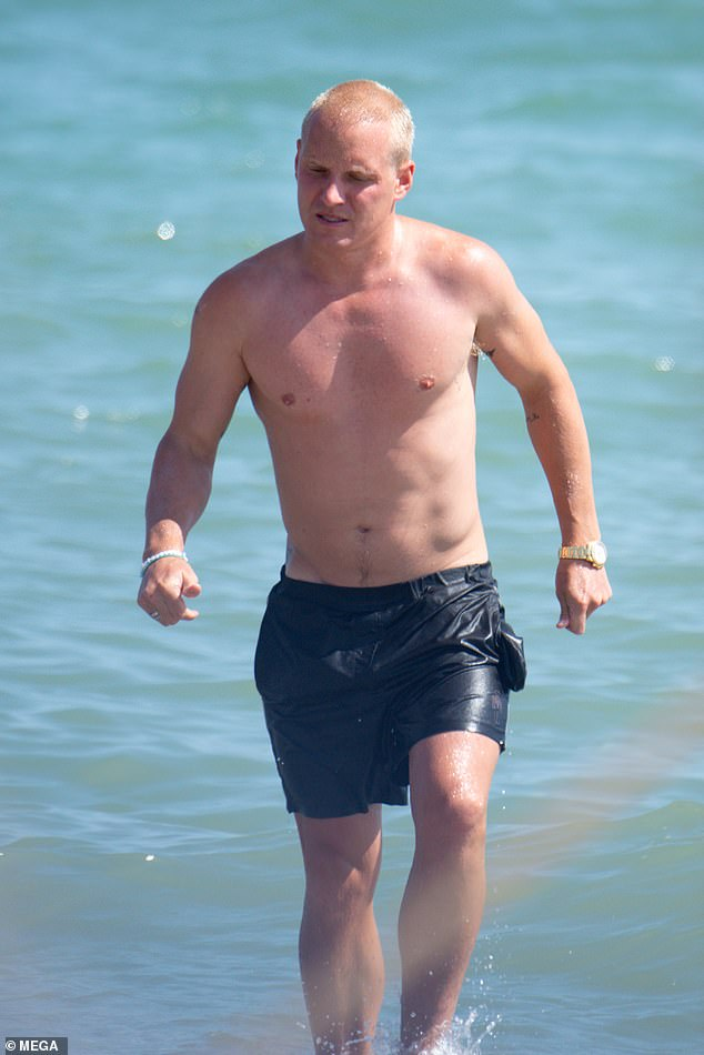 Looking good:Meanwhile, shirtless Jamie sported just a pair of black swim shorts as he joined his girlfriend in the sea, as they cooled off from the heat