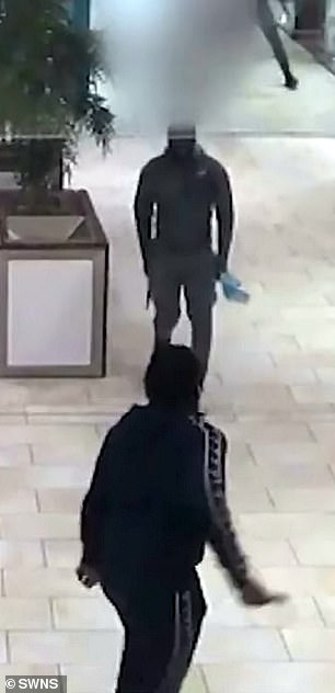 CCTV footage of the fight shows the gang members brandishing knives (above)