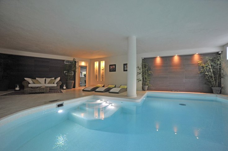 PANORAMIC VIEW PROPERTY POOL: Inside the Lake Maggiore property is a heated pool as well as a gym