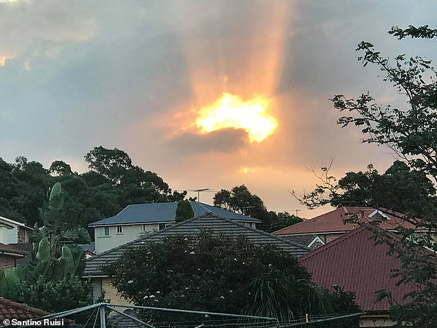 Father-of-three Santino Ruisi, 40, spotted an Australia-shaped cloudEdensor Park, in Sydney's west, in April