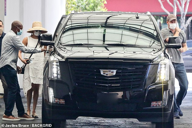 The Duke and Duchess of Sussex are pictured in Beverly Hills on July 10 getting into a gas-guzzling SUV which has been dubbed 'as far from environmentally-friendly as you can get'