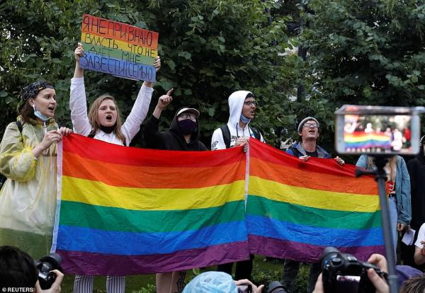 LGBT+ activists take part in a protest against Putin's constitutional reforms restricting their rights in Russia, image by Reuters