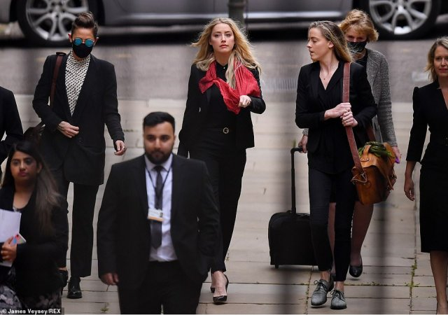 Amber Heard (centre) arrives at the High Court today with her girlfriend Bianca Butti (left) and sister Whitney Heard (right)