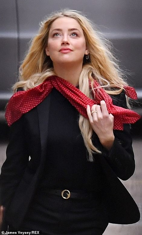 Amber Heard arrives this morning