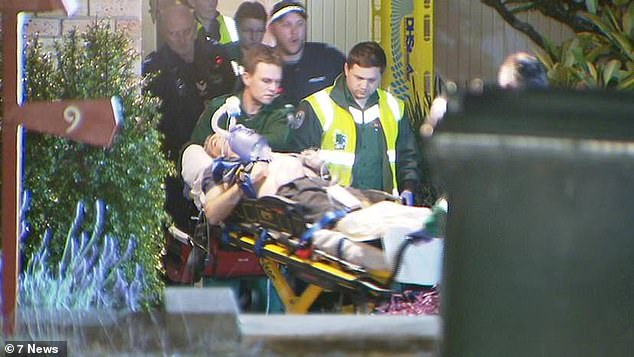 Shaun Mate (pictured with paramedics on a stretcher) was rushed to hospital after being found unconscious at the family's Eden Hills home, in Adelaide's south-east on the night of July 16