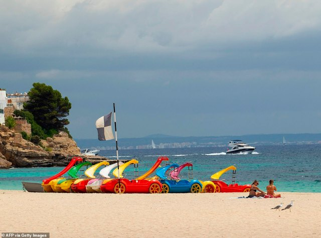 Two lone women appear to have the beach to themselves in Calvia