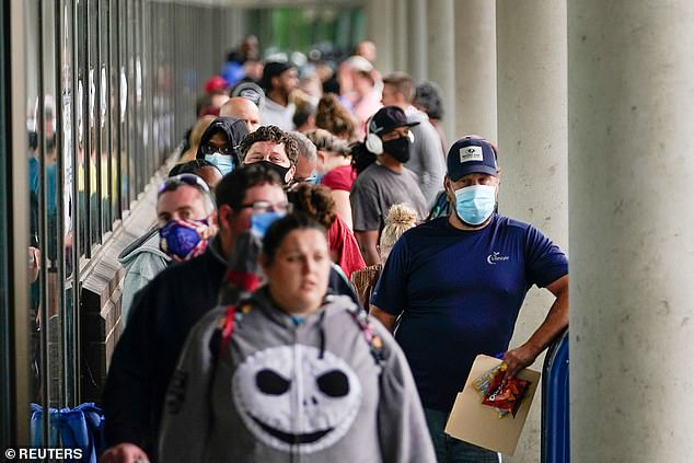Hundreds are pictured lining up for unemployment benefits in Frankfort, Kentucky. Freddy Mac warned that the
