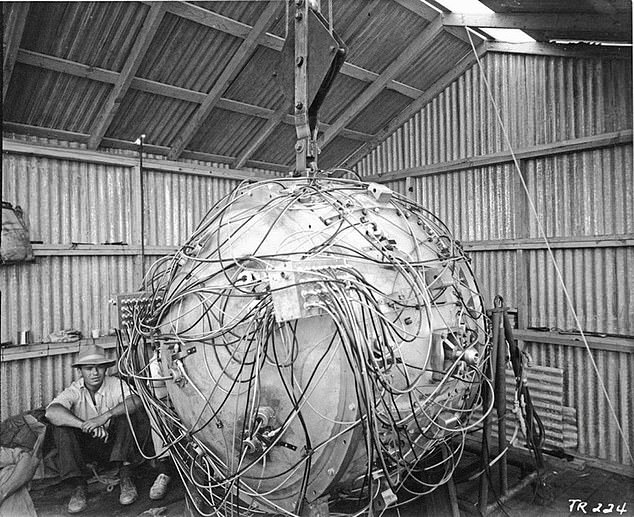 The bomb (above), known informally as 'the gadget,' was 'a Frankenstein's monster of wires, screws, switches, high explosives, radioactive materials, and diagnostic devices, and was crude enough that it could be tripped by a passing storm,' wrote the New Yorker
