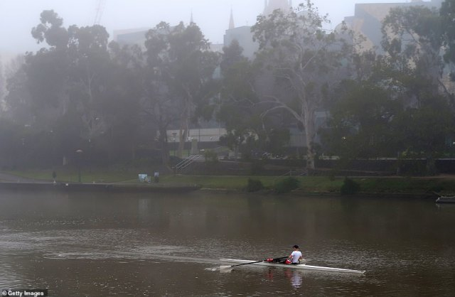 A rower is seen on the Yarra River on Friday morning. Residents are allowed to take exercise but must stay close to their homes