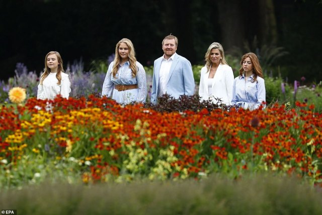 Partial to natural make-up, Maxima sported a dash of mascara, some blush and a slick of lipstick to compliment her summer glow. The family are pictured behind a bed of famous Dutch flowers in the palace garden. Queen Maxima (second right), Princess Amalia (second left), Princess Alexia (right) and Princess Ariane (left), King Willem-Alexander (centre), Queen Maxima (second right)