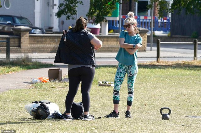 Pictured are two women making the most of the glorious weather and taking to Clapham Common for a bit of exercise