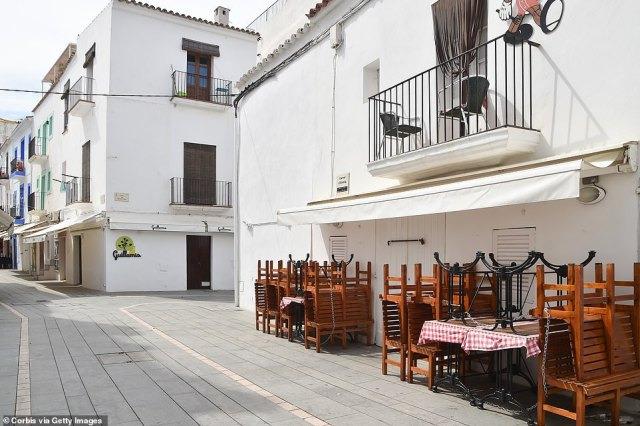 Even though the summer season has technically kicked off, Ibiza's streets remain very quiet. Pictured: A shuttered cafe on the island
