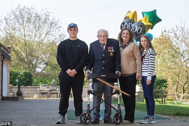Cptn Tom Moore, with (left to right) grandson Benji, daughter Hannah Ingram-Moore and granddaughter Georgia, at his home in Marston Moretaine, Bedfordshire