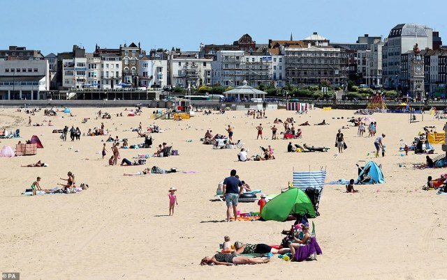 Sun-seekers are enjoying the warm weather on the beach in Margate, Kent, as parts of the UK enjoy glorious sunshine today