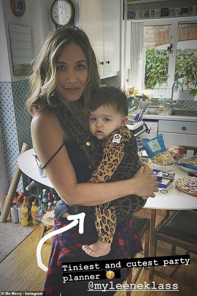 Cute! Myleene dressed baby Apollo, 11 months, in animal print for the party