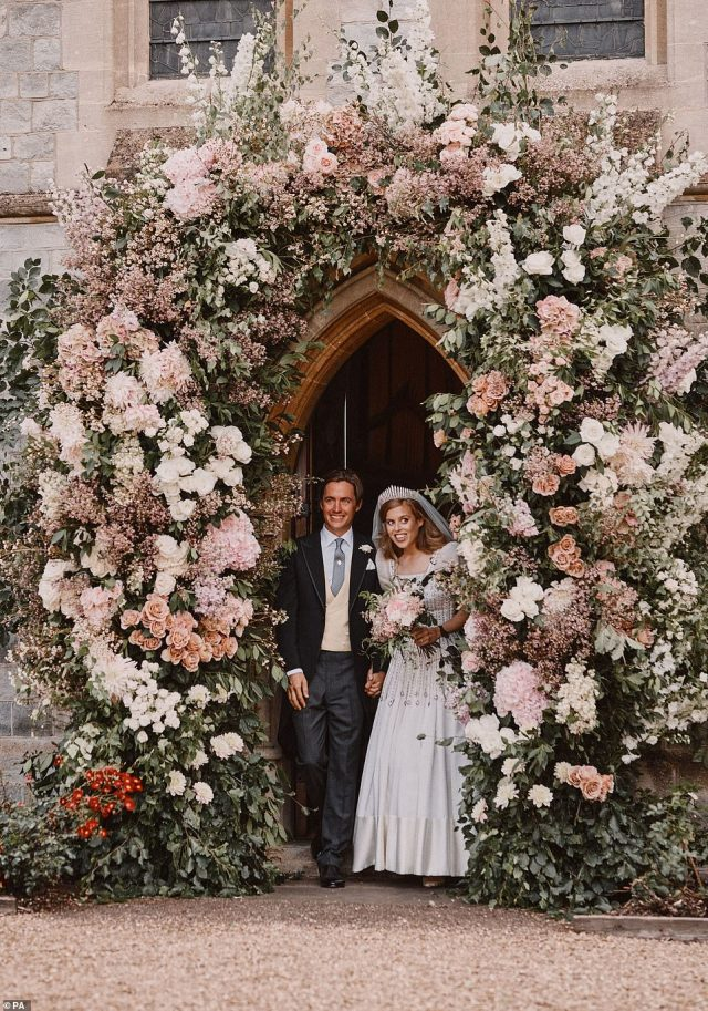 Buckingham Palace released Princess Beatrice'ss official wedding pictures on Saturday, the day after she tied the knot to Italian property developer Edo Mapelli Mozzi in a surprise ceremony. The stunning photos show Beatrice and Edo posing standing in the flower-adorned arch of the Royal Chapel of All Saints, in the grounds of Prince Andrew and Sarah Ferguson's home of Royal Lodge in Windsor Great Park