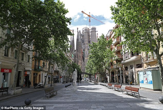 The Sagrada Familia (pictured), one of Barcelona's major tourist attractions, welcomed very few tourists over the weekend