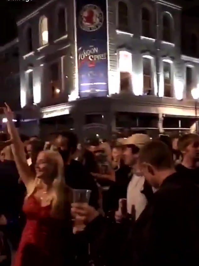 Members of the large crowd were seen dancing very close to each other like they were in a nightclub, which will remain closed until further notice