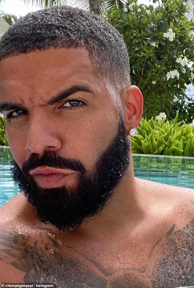 Taking a dip: He also served eyebrow in another selfie he posted from the pool, as he commented on his fade: 'Curls didn't last'