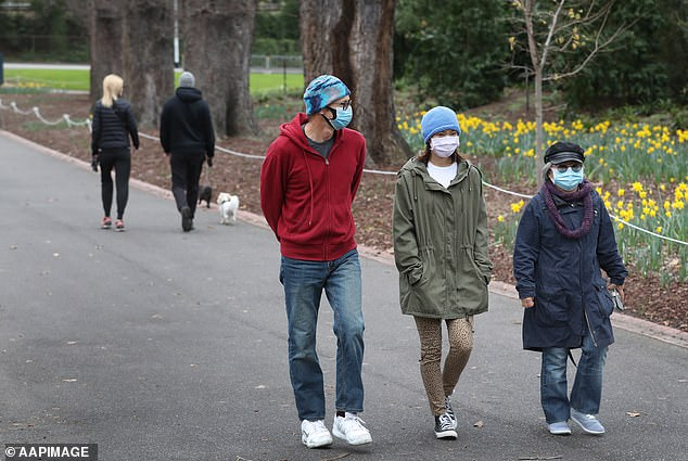 The only exceptions to the mask order will be for those for whom mask-wearing is not practicial or not possible for professional reasons. Pictured are a group of walkers at Fitzroy Gardens in East Melbourne on Saturday