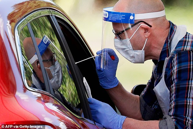 In a bid to better control any future outbreaks, it was today revealed that Mr Hancock will give in to local councils and allow access to the names and data of people in their areas who have tested positive for coronavirus , sources say. Pictured: A drive-through test centre inChessington in May
