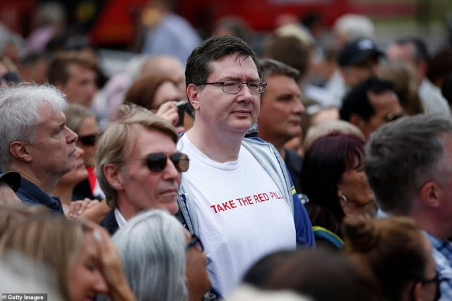 The crowd at the first ever Keep Britain Free march watch on as speakers address them at the gathering in Hyde Park today