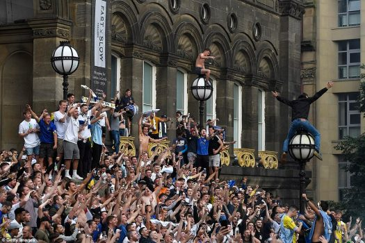 Leeds United fans celebrate Premier League promotion at ...