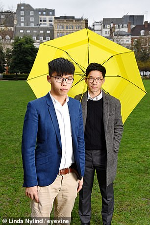 When he was only 23 years old when he became Hong Kong's youngest legislator, he gained instant notoriety using his swearing-in ceremony as the platform for his campaign. Nathan Law is pictured alongside Joshua Wong