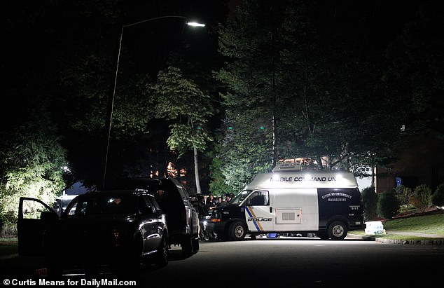 All manner of state and local law enforcement agencies were gathered outside the home on Sunday night