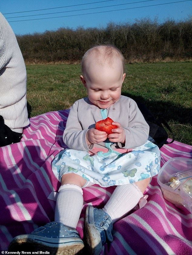 Paiva, pictured on a family day out, started to experience thinning hair when she was around a year old