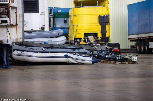 A deflated dinghy alongside a number of boat engines that have been used by migrants in recent crossings in the Channel