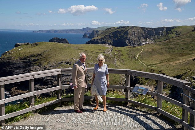 The couple posed for snaps at a lookout point while visiting the Tintagel Castle in the north of the county