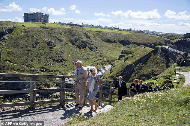 Prince Charles and Camilla strolled while visiting a lookout point close to the bridge to enjoy the summer sunshine