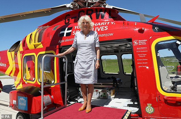 Camilla soaked up the summer sunshine while touring the Cornwall Air Ambulance Trust's base in Newquay on the first day of her visit to the county