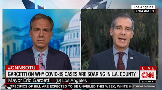 Los Angeles Mayor Eric Garcetti revealed on CNN's State of the Union that the city was 'on the brink' of another stay-at-home order as cases surge in the state