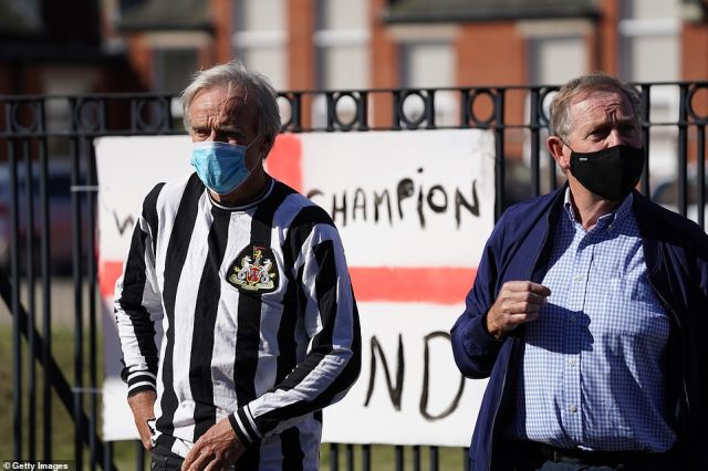 One man wears a 1970s retro Newcastle United shirt as people wait to pay tribute to Jack Charlton in Ashington today