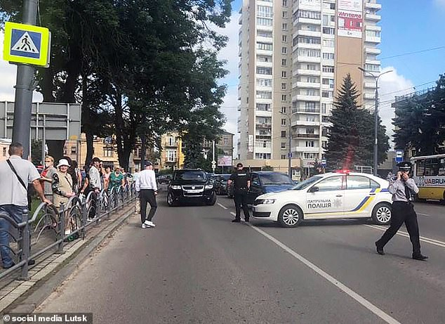 Onlookers began to gather as police blocked the road to the bus