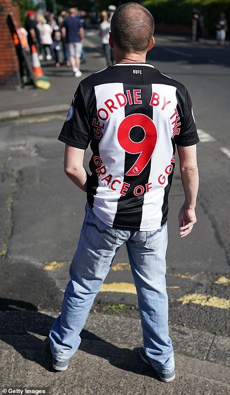 A man wears a Newcastle shirt in Ashington today