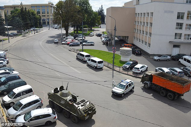 A tank parked at the scene to block the road following the seizure of the passenger bus