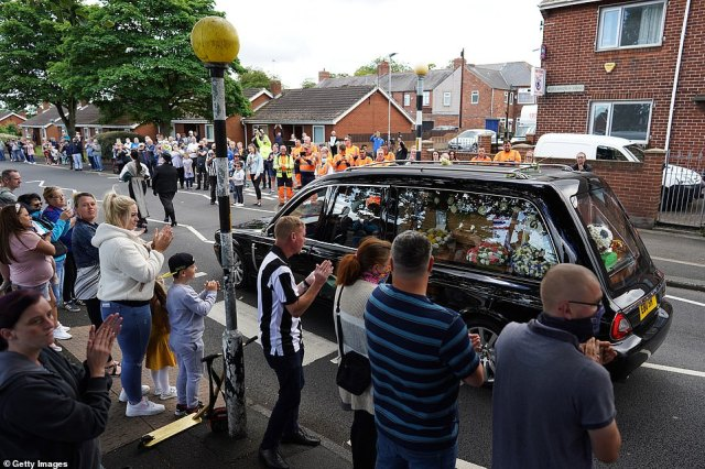 People line the streets to pay tribute to Jack Charlton as his funeral cortege passes through his hometown of Ashington today