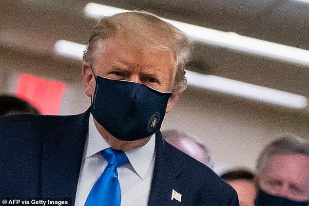 This photo from last week shows US President Donald Trump wearing a mask - a rare sight - as he visits Walter Reed National Military Medical Center in Bethesda, Maryland
