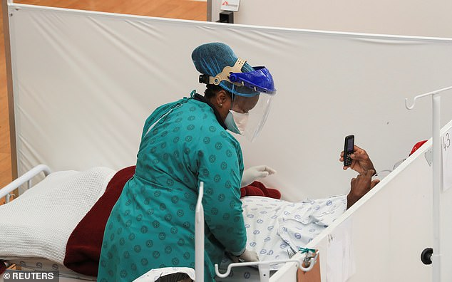 A health worker treats a patient at a temporary field hospital set up by Médecins Sans Frontières (MSF) during the coronavirus (COVID-19) epidemic in Khayelitsha township near Cape Town, South Africa, yesterday