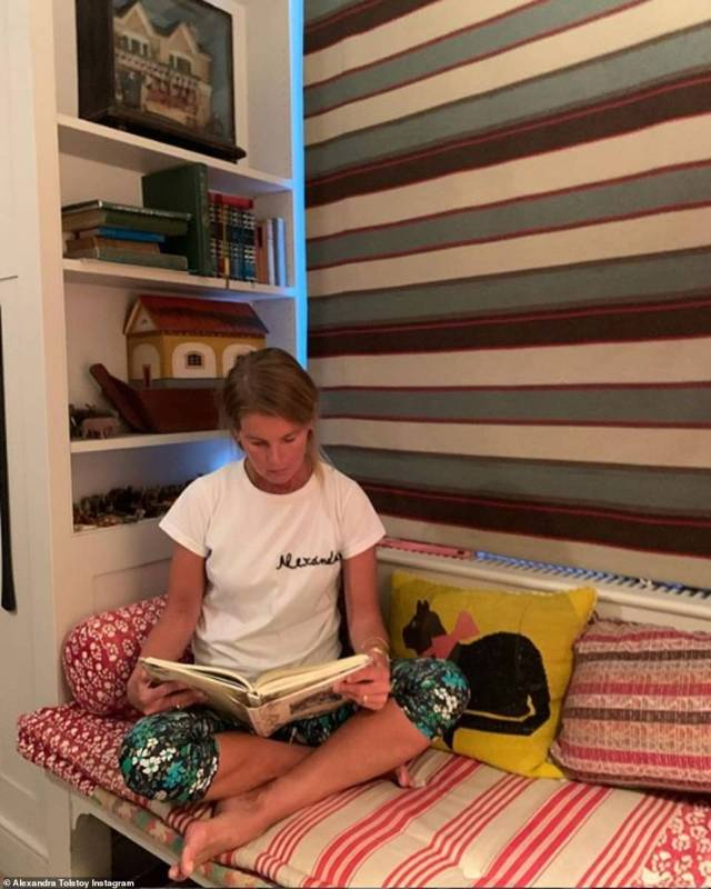 Alexandra is seen perched in a reading corner of multi-million pound South London property wearing a personalised t-shirt