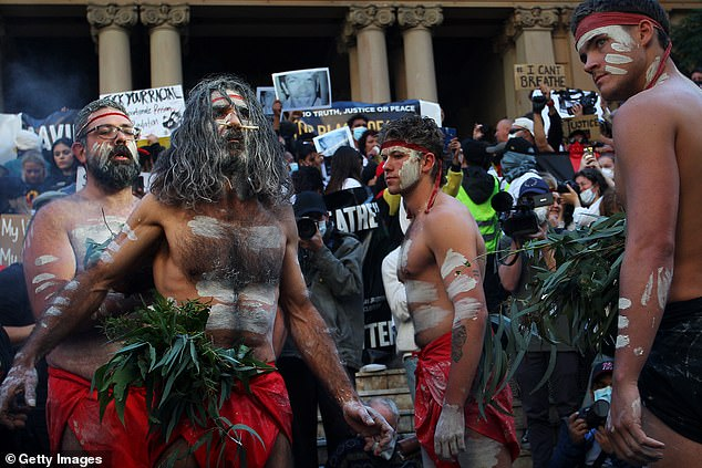 Mr Abbott said the idea that there is something 'fundamentally wrong, illegitimate and racist' about Australia 'does not stand up to serious scrutiny'. Pictured: Aboriginal protesters at a BLM protest march on June 06